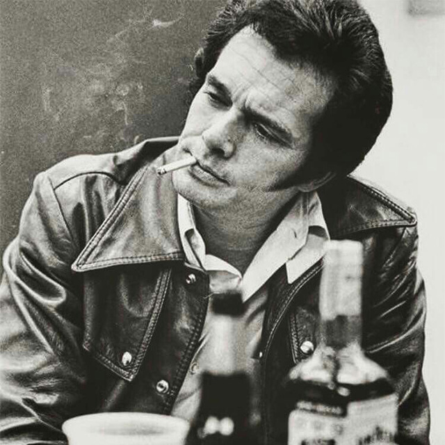 Merle Haggard with whiskey bottle