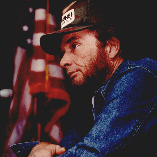 Merle Haggard with American flag