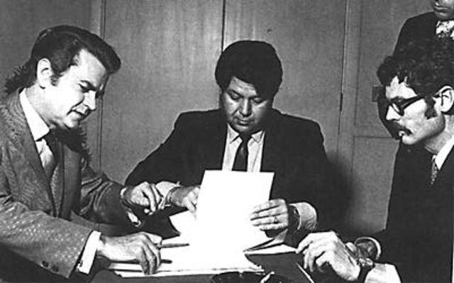 Shelby and Sam Phillips signing the papers