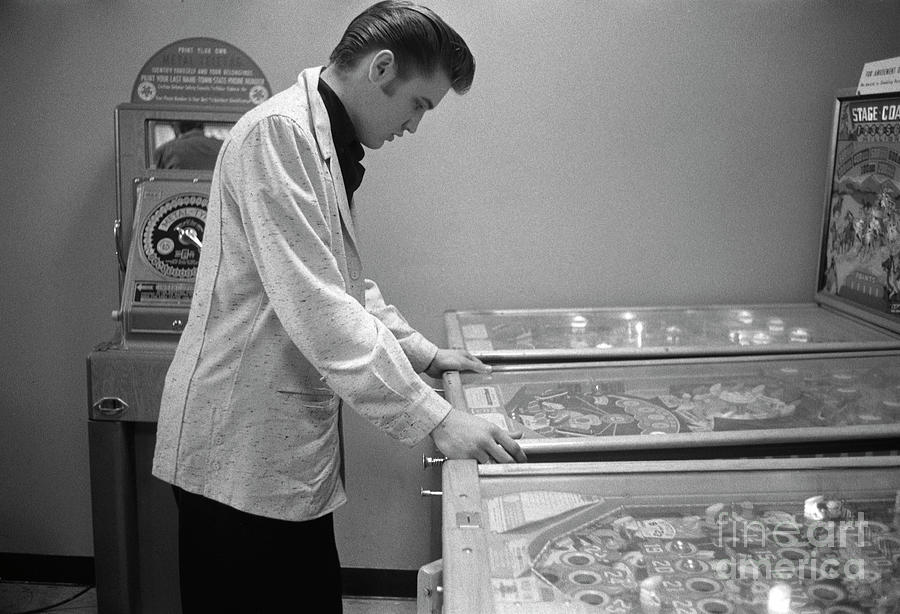 Elvis playing pinball in 1956