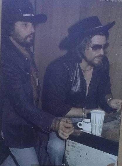 Waylon Jennings and Tompall Glaser playing pinball