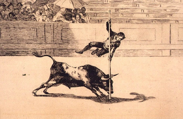 Pole vaulting over a charging bull