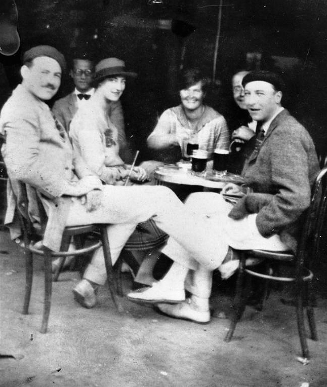 Ernest Hemingway and friends at a cafe in Pamplona