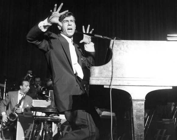 Johnnie Ray at a piano